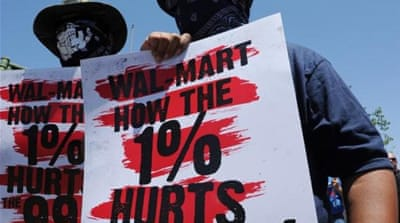 Labourers working in Walmart warehouses in California are forbidden from unionising and pushing for rights [AFP]