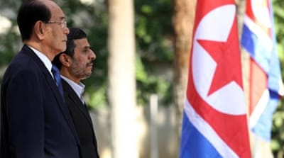 Iranian President Mahmoud Ahmadinejad meets with North Korea's ceremonial head of state, Kim Yong-nam [AFP]