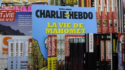 The Charlie Hebdo offices were fire-bombed after it published cartoons on the prophet last September [AFP]