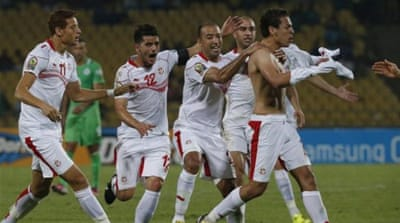 Msakni (C) celebrates with teammates after giving Tunisia an unlikely win in South Africa [Reuters]
