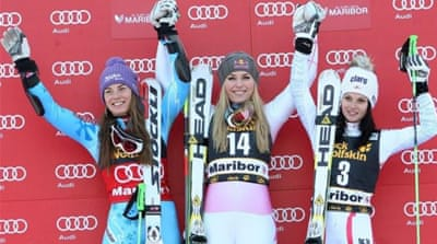 Race winner Vonn (R) shares a joke (hopefully not an insult) with new Queen of the slalom slopes Tina Maze [GETTY]