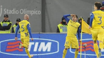 Chievo keeper Christian Puggioni (L) celebrates with teammate Bostjan Cesar after unlikely victory [AFP]