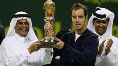 France's Richard Gasquet enjoys his bird trophy and an early victory in 2013 [AFP]