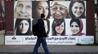 In the run-up to the 17th parliamentary elections in Jordan, campaign posters flood the streets of Amman [AP]