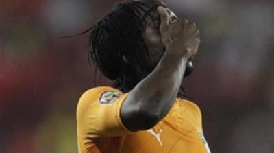 Gervinho (L) and teammates react after their shock lost to Zambia in the 2012 final [AP]