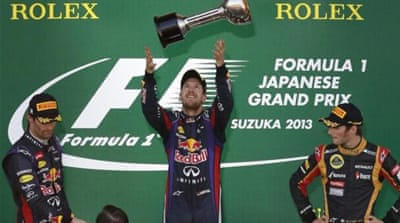 Mark Webber congratulates his team mate on another clinical race at Suzuka [Reuters]