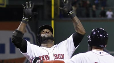 Ortiz celebrates with Jacoby Ellsbury after hitting a home run with bases loaded to down Detroit [AP]