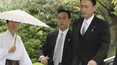 Keiji Furuya (right) arrives at the Yasukuni shrine in Tokyo [Reuters]