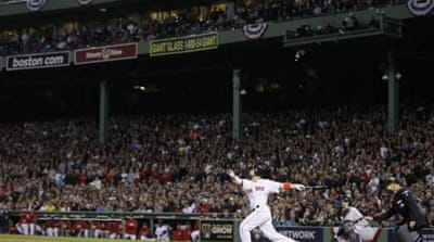 Victorino watches his home run sail over left field with bases loaded to give Boston an unassailable lead [AP]