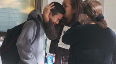 A Sparks pupil with family members after the attack [AP]