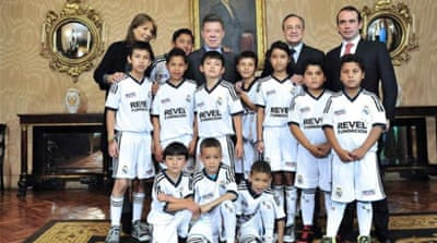 During a recent visit to Colombia, Real President Perez (C) toured 10 schools the foundation runs in Bogota [EPA]