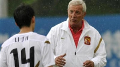 Lippi could become the first coach to win a World Cup, European Cup and Asian Champions League [AFP]
