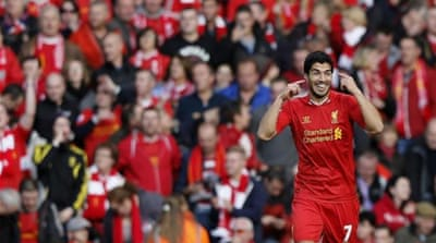 Suarez helped Liverpool stay within two points of Arsenal at the top of the table [Reuters]