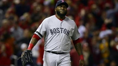 Red Sox David Ortiz (R) has been leading by example in World Series with eight of Boston's 24 hits [EPA]