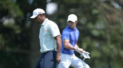 Good friends: Woods (R) has returned to the top spot but believes McIlroy (L) will be challenging for titles soon [AP]