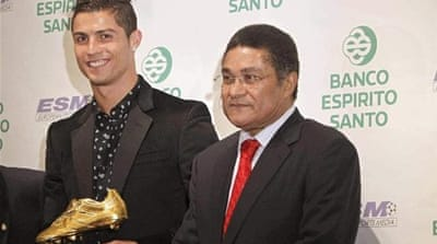 Who is the best? Ronaldo (R) receives the 2011 European Golden Shoe trophy alongside Eusebio (C) [Reuters]