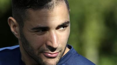 The media are not Benzema's (R) favourite people at the moment after struggling to regain his form [Reuters]