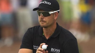 Swede lips: Stenson kisses the end-of-season trophy after strolling to victory in Dubai [AP]