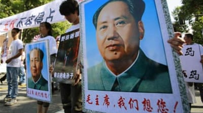 Mao's legacy remains mixed in China, where he is revered for the 1949 founding of the People's Republic [AP]