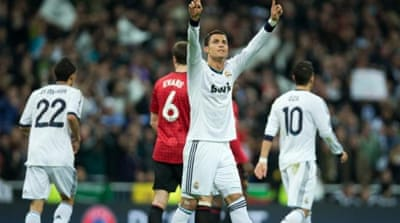 United's Welbeck (R) celebrates after scoring opening goal at Real Madrid's Bernabeu stadium [Reuters]
