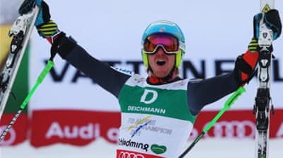 Defending champion Ted Ligety celebrates third gold medal at the finish in Schladming, Austria [GETTY]