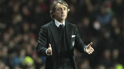 City boss Roberto Mancini (R) has watched his reigning champions struggle this season [EPA]