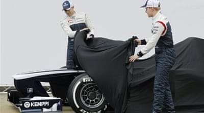 Williams F1 drivers Pastor Maldonado (L) and Valtteri Bottas pose with controversial new car [Reuters]