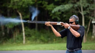 White House shows photo of Obama firing gun