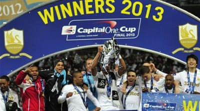 A jubilant Swansea City celebrate first major trophy in their 101-year history [AFP]