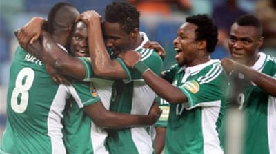 Nigeria's Elderson Echiejile celebrates after scoring first of four against Mali [Reuters}