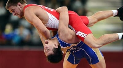 Wrestlers are fighting seven other sports for the final place on the 2020 Olympic Games program [EPA]