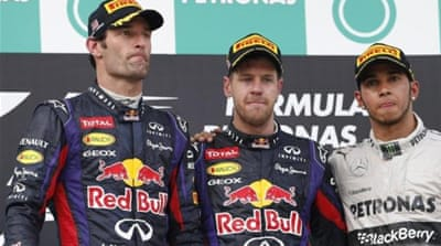 On the same team but heading in different directions? There is no love lost between victor Vettel and Webber [AP]