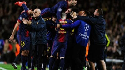 Barca's Pedro Rodriguez runs to celebrate with teammates after scoring crucial goal against PSG [AP]