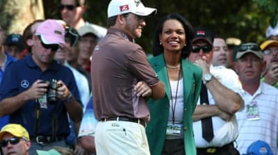 Augusta National member Condoleezza Rice (L) stands with Rory McIlroy (R) and Caroline Wozniacki [Reuters]