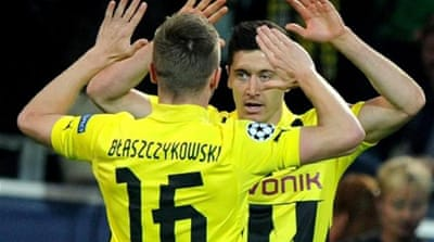 Easy as 1,2,3...4 - Dortmund's Lewandowski (R) celebrates his final goal of the night in Germany [AFP]