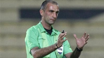 Referee Ali Sabbagh (pictured) and two assistants are latest to be questioned by CPIB [Reuters]