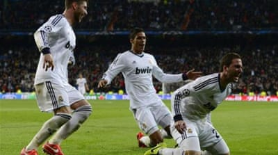 Ronaldo (R) and Ozil (2nd R) shone for Real Madrid as Mourinho's men punished Galatasaray's defence [EPA]