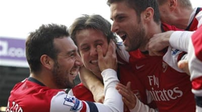 Tomas Rosicky (2R) was on form for Arsenal scoring two and clearing a header off the line [AFP]