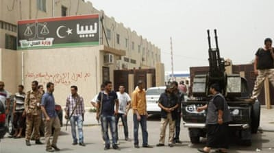 The armed groups first surrounded the ministries in Tripoli late last month [Reuters]