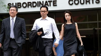 Pop star Sun Ho's husband is accused of siphoning millions from the mega-church he runs in Singapore [AP]