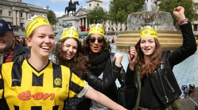 Capital invaded: Borussia Dortmund fans gather together in Trafalgar Square ahead of European season climax [EPA]
