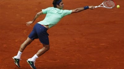 Back on the scene, dressed in green: Federer defeated Stepanek in straight sets [AFP]