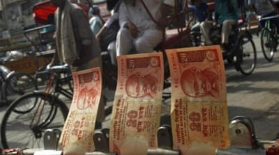 The Indian rupee hit a record low on Monday, weighed down by broad gains in the dollar [Reuters]