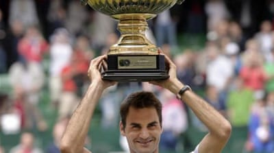 Federer won his first title since Cincinnati in August 2012 and his sixth in Halle, the first since 2008 [AP]