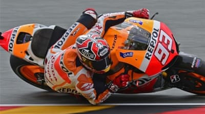 Honda rider Marc Marquez starts ahead of Britain's Cal Crutchlow and Valentino Rossi [AP]