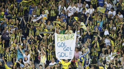 Fenerbahce's Dirk Kuyt (L) is not happy with the ruling that sees club banned from Europe once more [AP]