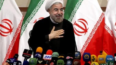 Hassan Rouhani will succeed Mahmoud Ahmadinejad as Iran's president on August 3 [AP]