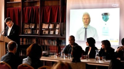 Assange made the announcement with a videolink from London to Melbourne's Fitzroy library [EPA]