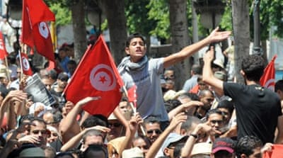 Tunisia marked a day of mourning on Friday after gunmen killed a leading opposition figure [AFP]