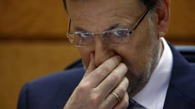 Spain PM admits mishandling funding scandal